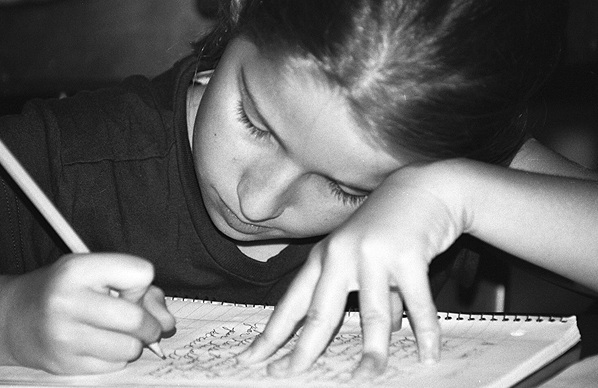 A child studying; photo courtesy Pamala Wilson