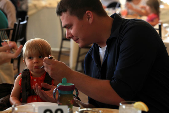 Feeding the child on Father's Day; image © USMC