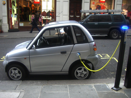 The REVAi/G-Wiz i electric car charging at an on-street station in London.; photo courtesy frankh