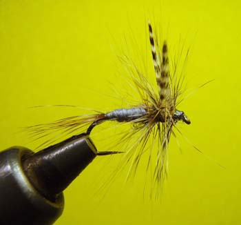 Tying a dry fly; photo courtesy Mike Kline