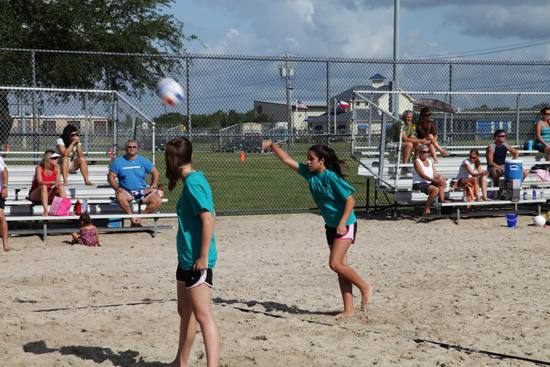 Sand volleyball serve; photo courtesy Kelly Smith