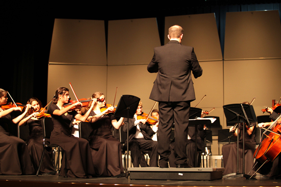 Mr. Washburn directing Clear Falls High School Orchestra; photo courtesy KSmith Media, LLC